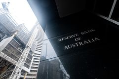 MELBOURNE, AUSTRALIA - JULY 26, 2018: Reserve Bank of Australia name on black granite wall in Melbourne Australia with a. Reflection of high-rise buildings. The stock photos