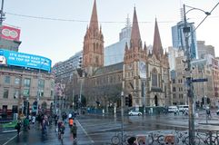 MELBOURNE, AUSTRALIA - JULY 29, 2018: St Paul`s Cathedral in Melbourne central business district near Federation square. There ar stock photo