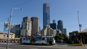 Melbourne, Australia - March 29, 2018: Tram going on the Princess bridge with skyscrapers of Melbourne downtown in the background. Melbourne, Australia - March Royalty Free Stock Image