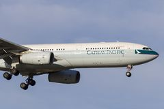 Cathay Pacific Airbus A330-343 airliner B-LAK on approach to land at Melbourne International Airport. stock photos
