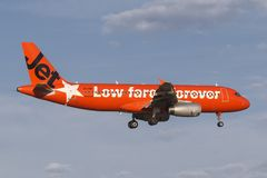 Jetstar Airways Airbus A320 VH-VGT at Melbourne International Airport in a bright orange `#jetstargeneration` livery. royalty free stock photo