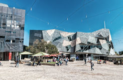 MELBOURNE, AUSTRALIA - OCTOBER 10, 2015: Iconic Federation Square on a dpring day. It is a mixed-use development in the inner cit. Y of Melbourne, covering an royalty free stock photo