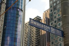 Melbourne, Australia - September 21st 2018: Swanston Street Sign and Towers Under Construction in the Background royalty free stock photos