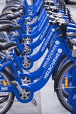 Melbourne Bike Share Station. Parked blue bicycles at Melbourne Bike Share Station, Australia Royalty Free Stock Photos