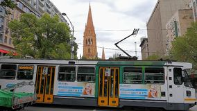 Melbourne city center. MELBOURNE, AUSTRALIA - MARCH 16, 2015: Busy Swanston street in city center and Cathedral of Saint Paul in background stock video footage