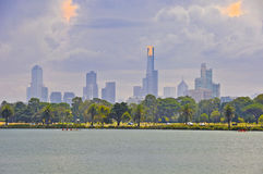 Melbourne City Skyline. Under gathering storm clouds with Albert Park & Lake in the foreground and the Eureka Skydeck 88 building being prominent Royalty Free Stock Photos