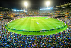 Melbourne cricket ground MCG view from stand under floodlights. Cricket match at evening in Melbourne cricket ground MCG Victoria Australia Royalty Free Stock Photos