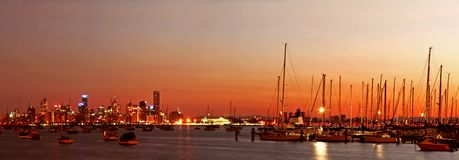 Melbourne at Dawn. Panorama of Melbourne, Australia, before dawn, with marina in foreground. Viewed from Williamstown stock images
