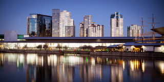 Melbourne Exhibition Centre At Night. Melbourne Exhibition Centre from over the Yarra River at dusk. Polly Woodside can be seen to the right. In Melbourne Stock Images