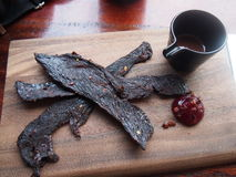 Melbourne Fine Foods. A hidden gem in Melbournes suburbs plating up a dish of Kangaroo jerky with chocolate sauce and hibiscus gel Stock Photo