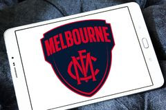 Melbourne Football Club logo. Logo of Melbourne Football Club on samsung tablet. The Melbourne Football Club, nicknamed the Demons, is a professional Australian Royalty Free Stock Photos