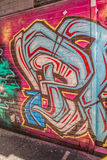 Melbourne graffiti detail. MELBOURNE, AUSTRALIA - MARCH 21, 2015: Colorful graffiti detail in back alley of downtown stock photos