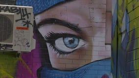 Melbourne graffiti woman face stock footage