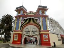 Melbourne Luna Park amusement park entrance with people royalty free stock photo
