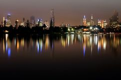 Melbourne by Night. The skyline of Melbourne, Australia, reflected in Albert Park Lake royalty free stock image