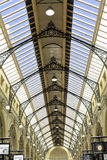 Melbourne Royal Arcade. The Royal Arcade features a high glass roof and rows of arched windows to the storerooms above each shop Stock Photos