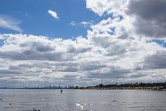 Melbourne skyline seen from Brighton Beach. Fisherman in the sea at Brighton, Australia Stock Photo