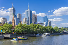Melbourne skyline with sightseeing ferry and restaurant Royalty Free Stock Photos