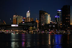 Melbourne skyline after sunset seen from dock lands Royalty Free Stock Photography