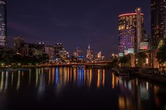 Melbourne Southbank at Night. Night time view of the Melbourne city skyline as seen from the Southbank of the Yarra river Stock Photo