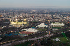 Melbourne sporting precinct of Melbourne Cricket Ground by the Yarra. Aerial view of the Melbourne sporting precinct in Australia.  In the foreground is the Stock Photo