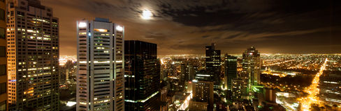 Melbourne-Stadt-Skyline am Nachtpanorama Stockbild