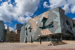 Melbourne tourist landmark and attraction FEderation square on sunny day. Melbourne, Australia - December 8, 2016: Melbourne tourist landmark and attraction stock images