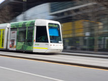 Melbourne Tram. Pan shot of a Melbourne Tram zooming past Southern Cross Station Royalty Free Stock Images