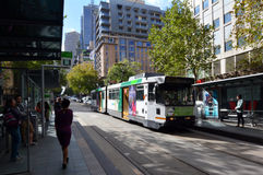 Melbourne tramway network. MELBOURNE, AUS - APR 13 2014:Melbourne tramway on Collins St.It's the largest urban tramway network in the world, consisted of 250 km Royalty Free Stock Photography