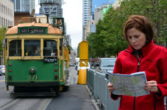 Melbourne tramway network. MELBOURNE,AUS - APR 11 2014:Tourist wait to Melbourne tramway.It's the largest urban tramway network in the world consisted of 250 km Stock Photos