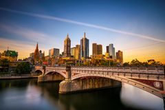 Sunset over skyline of Melbourne downtown, Princess Bridge and Yarra River Royalty Free Stock Images