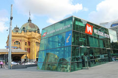 The Melbourne Visitor Centre at Federation Square with  Flinders Street Station in the background Stock Image