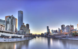 Melbourne from the Yarra. Both sides of the Yarra river in one shot showing SouthBank and the iconic Flinders Street station on a beautiful Melbourne day Royalty Free Stock Photos