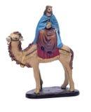 Melchior Magi die een kameel berijdt Stock Foto
