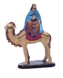 Melchior Magi riding a camel Stock Photo