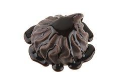 Melcochas en el chocolate aislado en blanco Imagenes de archivo