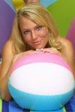 Meldungkugel mit blondem Schätzchen Stockbilder