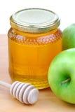 Mele e miele verdi Immagine Stock
