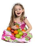 Mele ed arancio di risata del briciolo della ragazza Immagini Stock Libere da Diritti