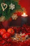 Mele, pan di zenzero e candela Fotografie Stock