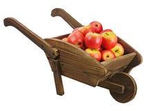 Mele rosse sul carretto a mano di legno isolato su fondo bianco. Fotografia Stock Libera da Diritti
