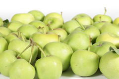Mele verdi piccole su bianco Fotografie Stock