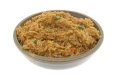 Melhore o arroz flavored em uma bacia com uma forquilha Imagem de Stock Royalty Free