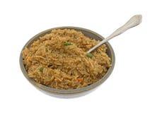Melhore o arroz flavored em uma bacia com uma forquilha Fotos de Stock Royalty Free