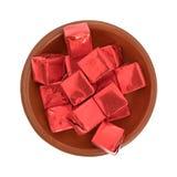 Melhore os cubos de caldo flavored envolvidos em uma opinião superior da bacia Imagem de Stock