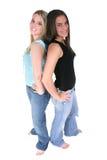 Melhores amigos com os pés descalços sobre o branco Foto de Stock