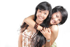 Melhores amigos que sorriem sobre o backgroun branco Foto de Stock
