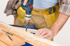 Melhoria Home - madeira da perfuração do trabalhador manual Imagem de Stock Royalty Free