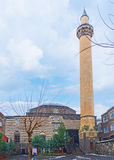 Melik Ahmet Mosque. The high white minaret and striped building of Melik Ahmet Pasha Mosque located on the same named street in the old town, Diyarbakir, Turkey Royalty Free Stock Image