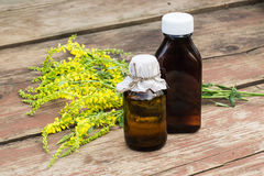 Melilotus officinalis and pharmaceutical bottles Stock Photos